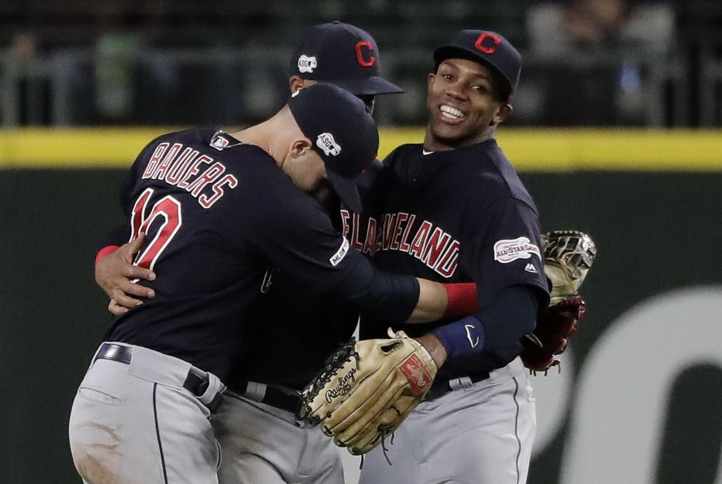 Cleveland Indians outfielders, from left, Jake Bauers, Leonys Martin, and Greg Allen, right, celebrate at the end of the ninth inning after the Indian
