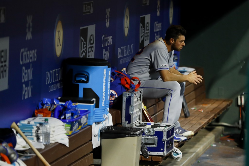 New York Mets starting pitcher Steven Matz sits in the dugout after being pulled during the first inning of a baseball game against the Philadelphia P