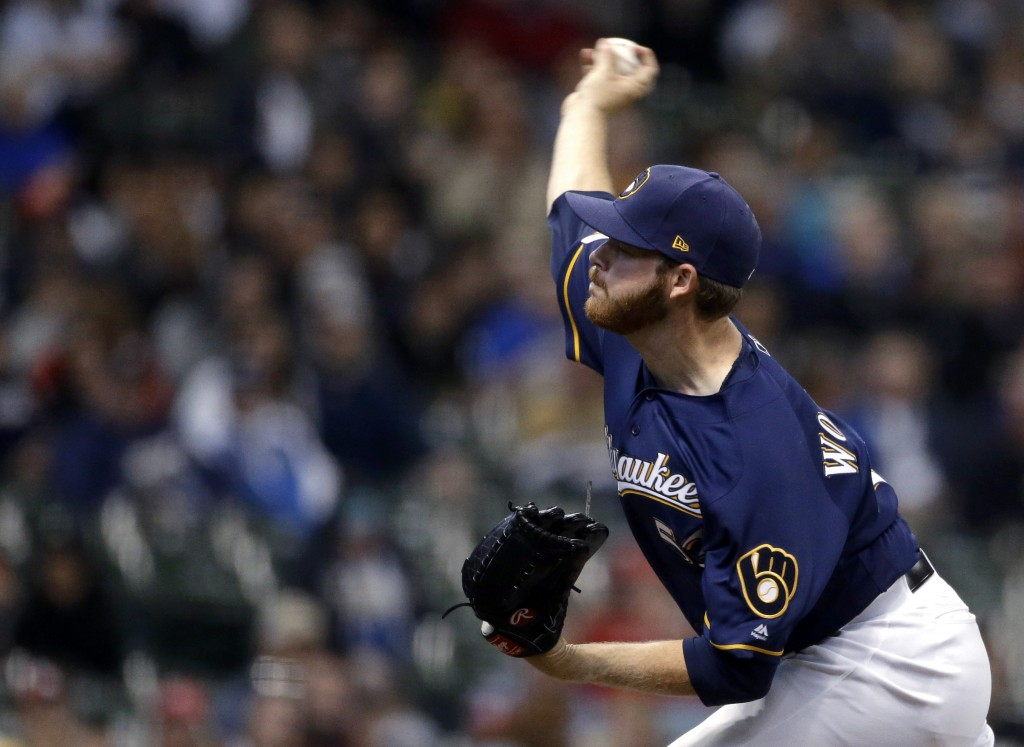 Milwaukee Brewers' Brandon Woodruff pitches during the first inning of the team's baseball game against the St. Louis Cardinals on Tuesday, April 16,