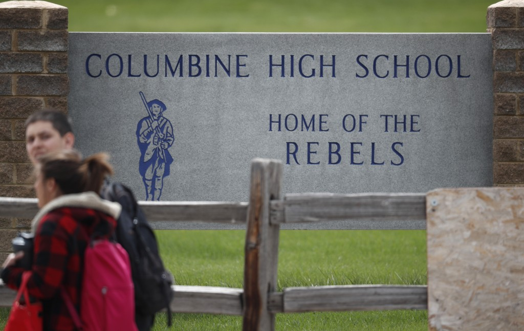 Students leave Columbine High School late Tuesday, April 16, 2019, in Littleton, Colo. Following a lockdown at Columbine High School and other Denver