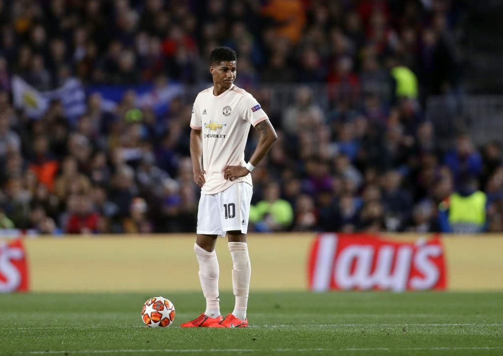 Manchester United's Marcus Rashford reacts after Barcelona forward Philippe Coutinho scores his side's third goal during the Champions League quarterf