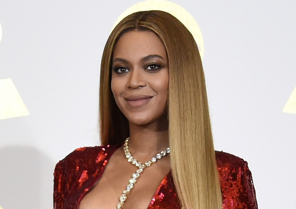 FILE - In this Feb. 12, 2017 file photo, Beyonce poses in the press room at the 59th annual Grammy Awards in Los Angeles.  Beyonce has released a soun