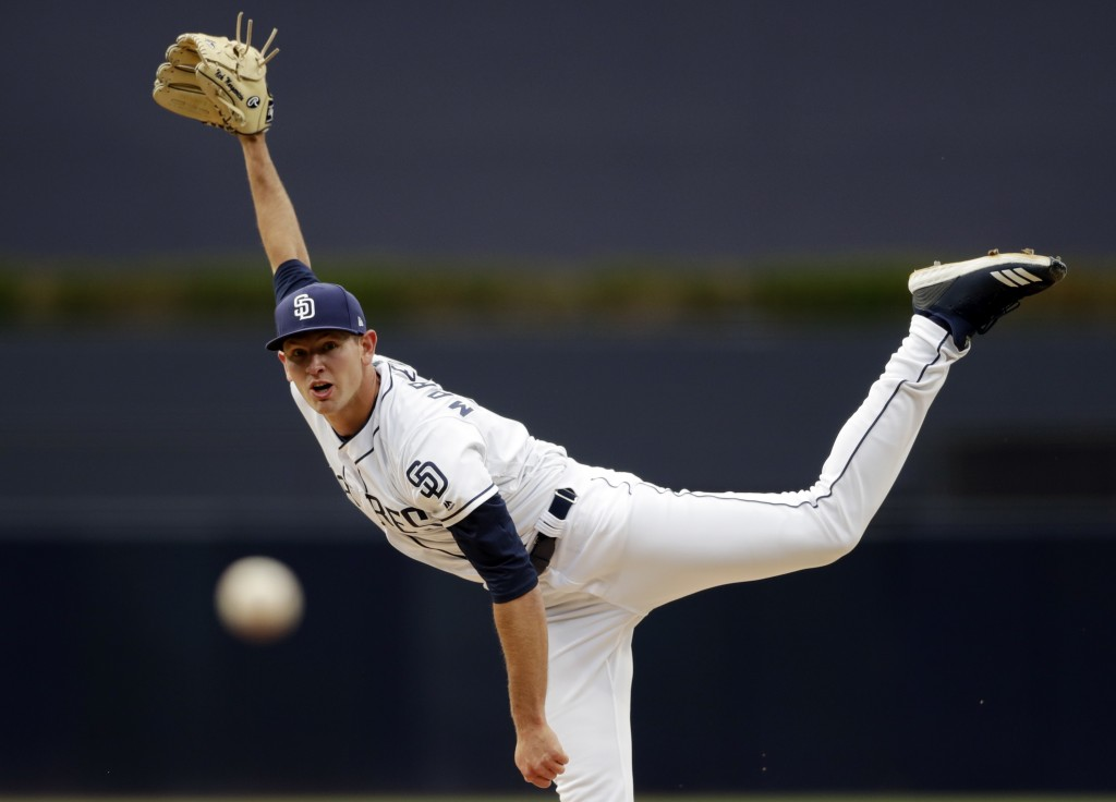 San Diego Padres starting pitcher Nick Margevicius works against a Colorado Rockies batter during the first inning of a baseball game Tuesday, April 1