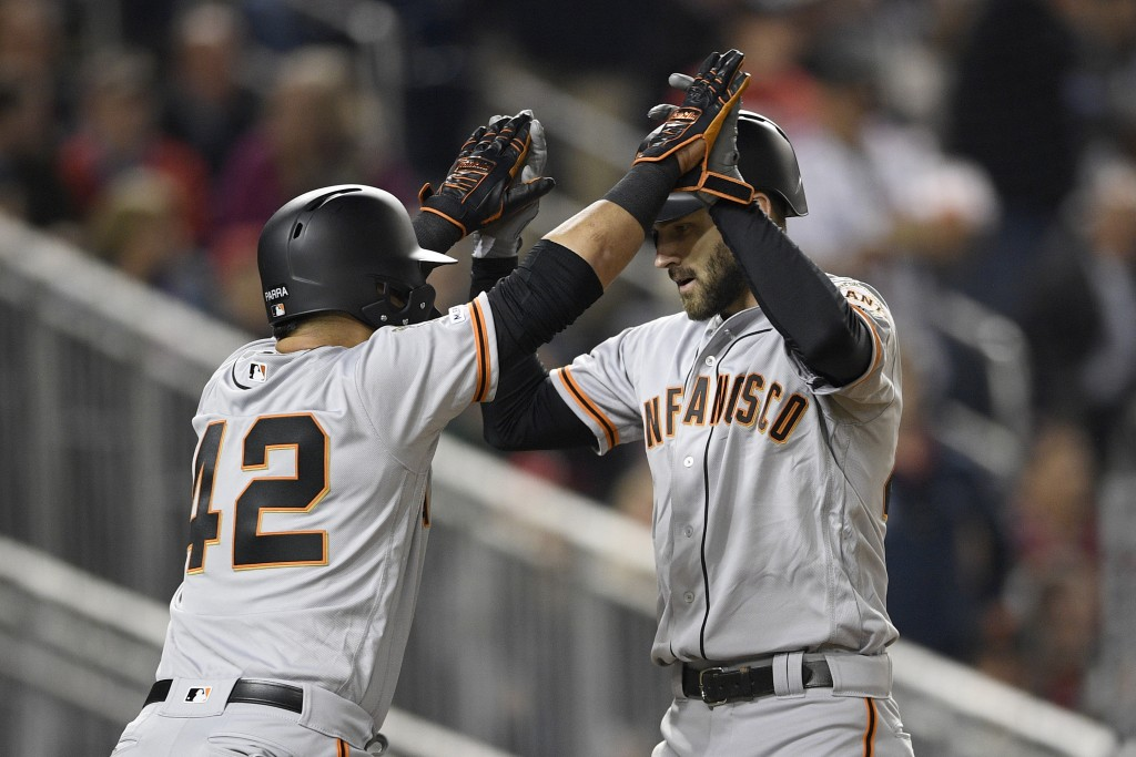 San Francisco Giants' Steven Duggar, right, celebrates his two-run home run with Gerardo Parra during the fifth inning of the team's baseball game aga