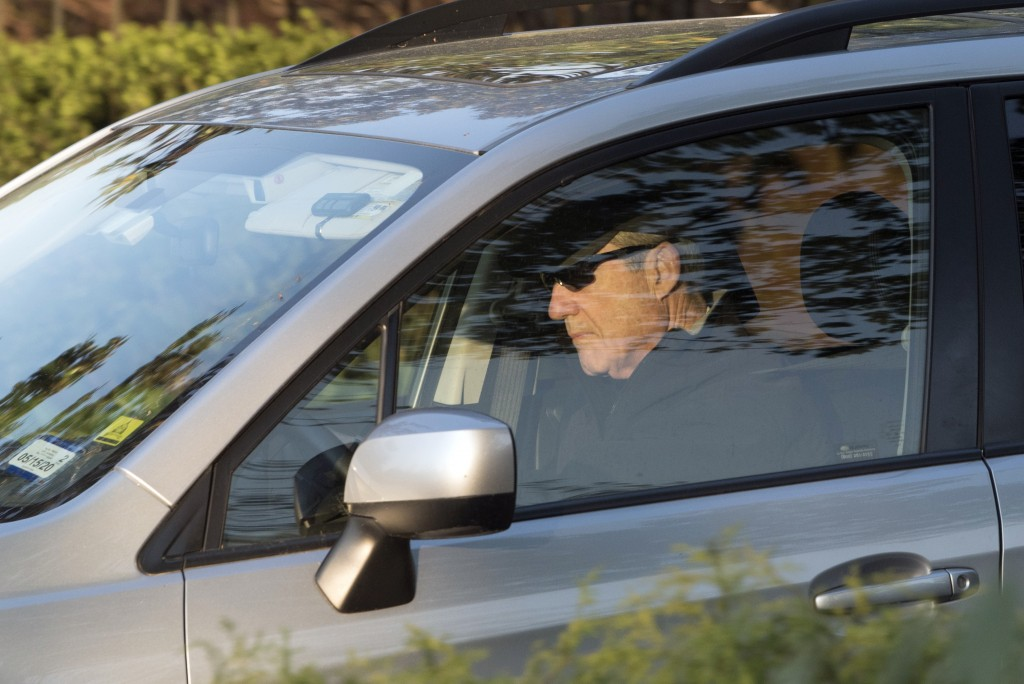 Special counsel Robert Mueller drives away from his Washington home on Wednesday, April 17, 2019. Outstanding questions about the special counsel's Ru