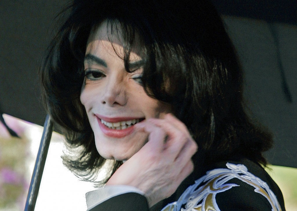 FILE - In this Dec. 17, 2004, file photo, pop star Michael Jackson gestures after greeting several hundred children who were invited guests at his Nev