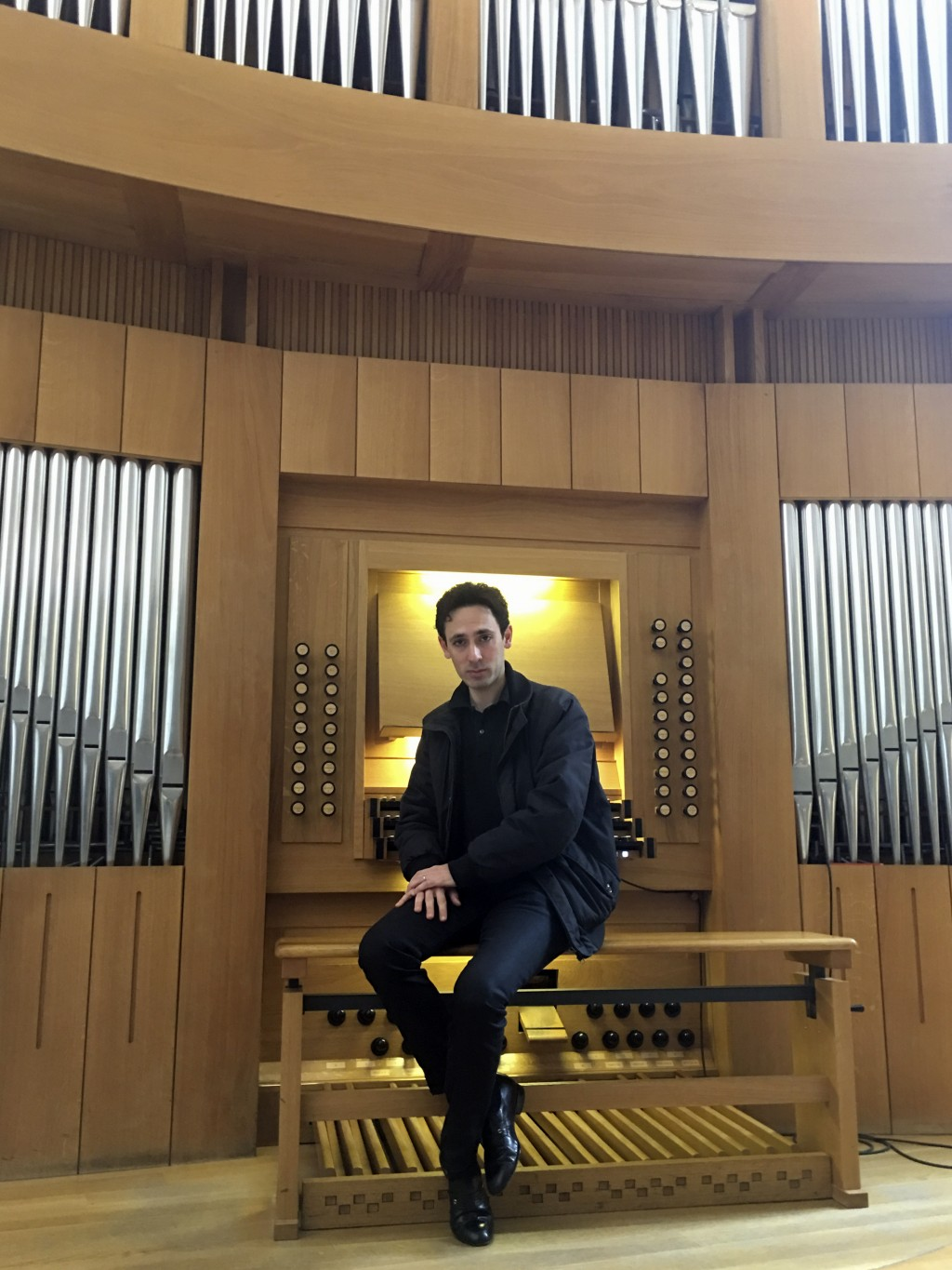 Vincent Dubois, organist at the Great Organ of Notre-Dame de Paris, poses at the organ at Strasbourg Conservatoire (music school), eastern France, Wed