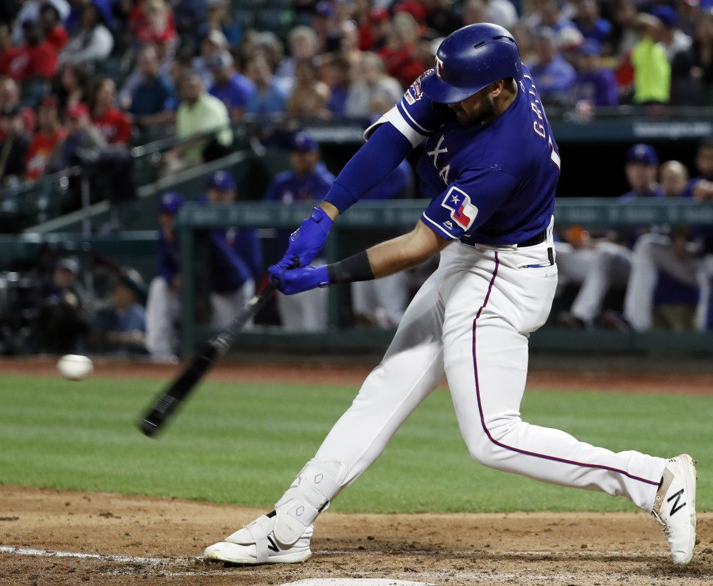 Texas Rangers' Joey Gallo connects for a two-run home run off Los Angeles Angels relief pitcher Dillon Peters during the sixth inning of a baseball ga