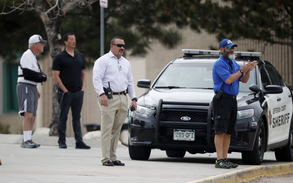 School police officers look on as students leave Columbine High School late Tuesday, April 16, 2019, in Littleton, Colo. Following a lockdown at Colum...