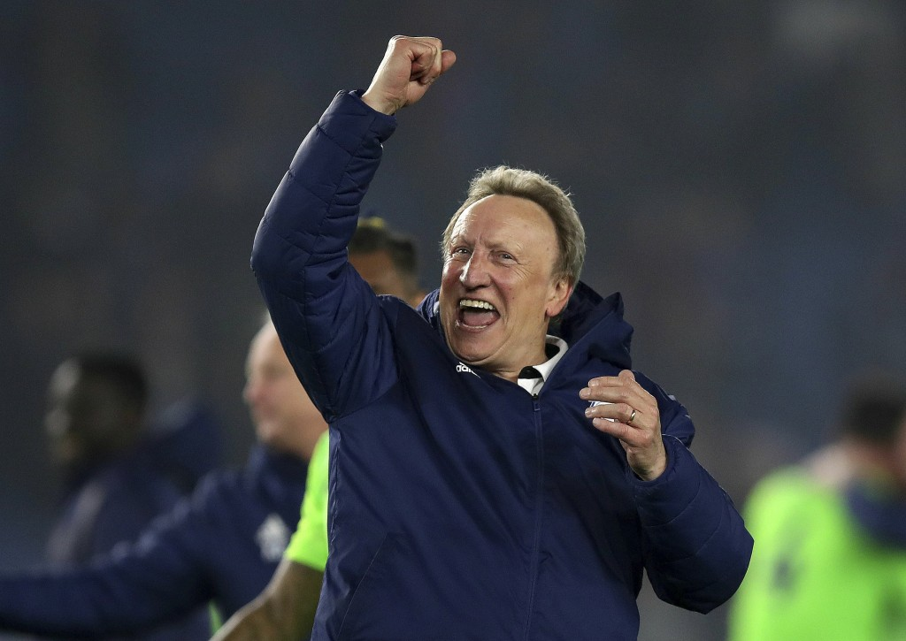 Cardiff City manager Neil Warnock celebrates their 0-2 win against Brighton in the English Premier League soccer match at the AMEX Stadium, Brighton,