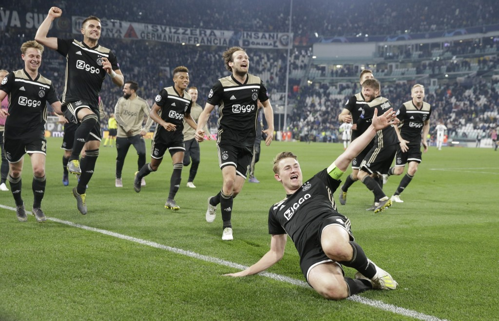 Ajax's Matthijs de Ligt and teammates celebrate at the end of the Champions League, quarterfinal, second leg soccer match between Juventus and Ajax, a
