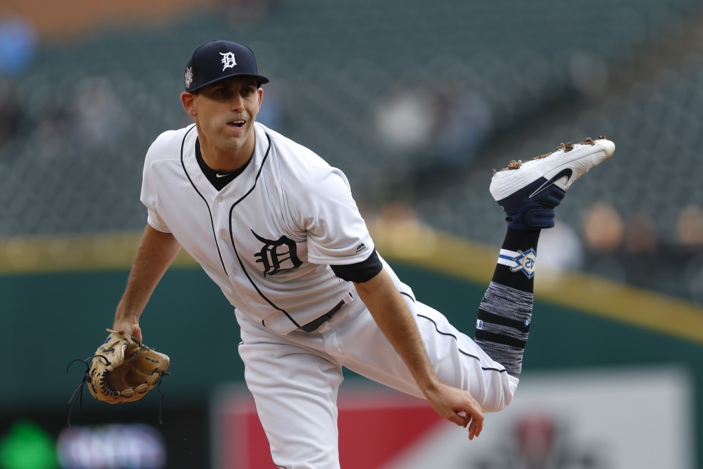 Detroit Tigers pitcher Matthew Boyd watches a delivery to the Pittsburgh Pirates during the first inning of a baseball game in Detroit, Tuesday, April