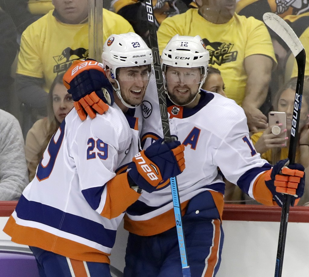 New York Islanders' Brock Nelson (29) celebrates his goal with Josh Bailey (12) during the first period in Game 4 of an NHL first-round hockey playoff