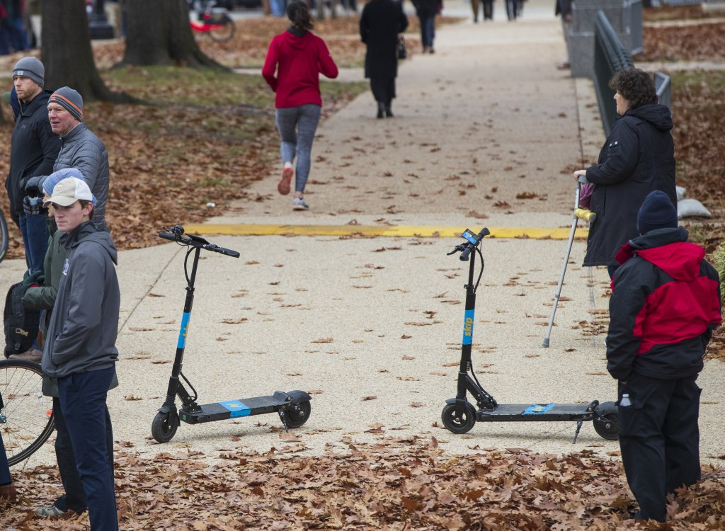 In this Dec. 5, 2018, photo Skip brand electric scooters are left on a sidewalk on Capitol Hill in Washington. Riders took 38.5 million trips on share