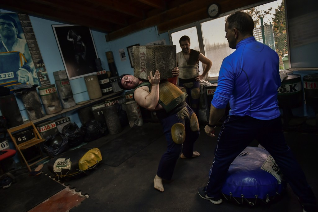 In this Wednesday April 10, 2019 photo, Inigo Eizagirre, 24, a basque stone lifter, holds a 100 kilograms stone during a training session in the basqu...