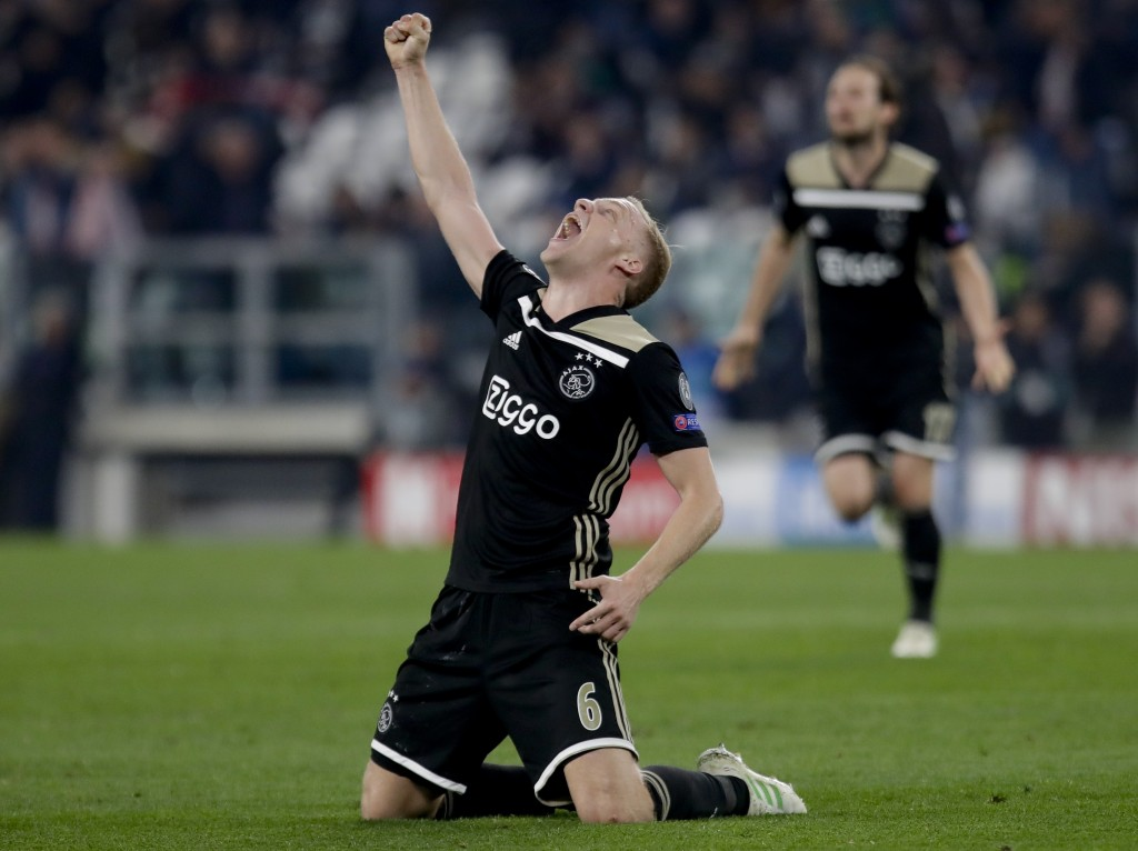 Ajax's Donny van de Beek celebrates at the end of the Champions League, quarterfinal, second leg soccer match between Juventus and Ajax, at the Allian