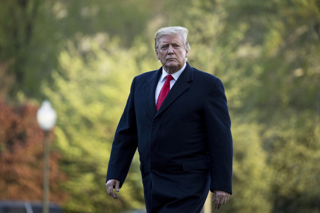 FILE - In this April 15, 2019, file photo, President Donald Trump walks on the South Lawn as he arrives at the White House in Washington.  Trump on Tu