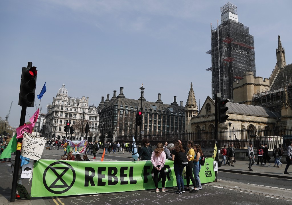 Protestors block the roads in parliament square in London, Wednesday, April 17, 2019, with Big Ben's clock tower shrouded in scaffolding back right. T