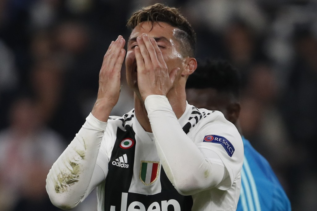 Juventus' Cristiano Ronaldo reacts after missing a scoring chance during the Champions League quarter final, second leg soccer match between Juventus ...