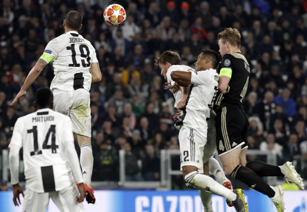 Ajax's Matthijs de Ligt, right, scores his side's second goal during the Champions League, quarterfinal, second leg soccer match between Juventus and