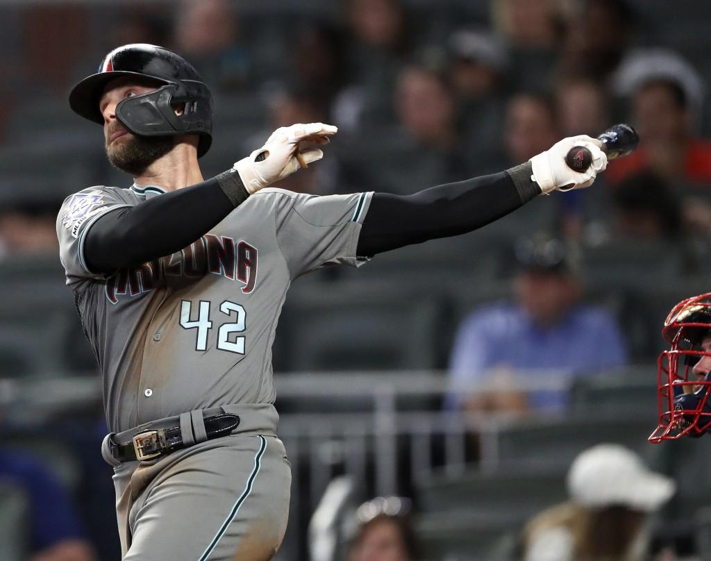 Arizona Diamondbacks' Christian Walker (53) follows through on a solo-home run in the ninth inning of a baseball game against the Atlanta Braves, Tues...