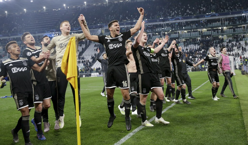 Ajax players celebrate at the end of the Champions League, quarterfinal, second leg soccer match between Juventus and Ajax, at the Allianz stadium in ...