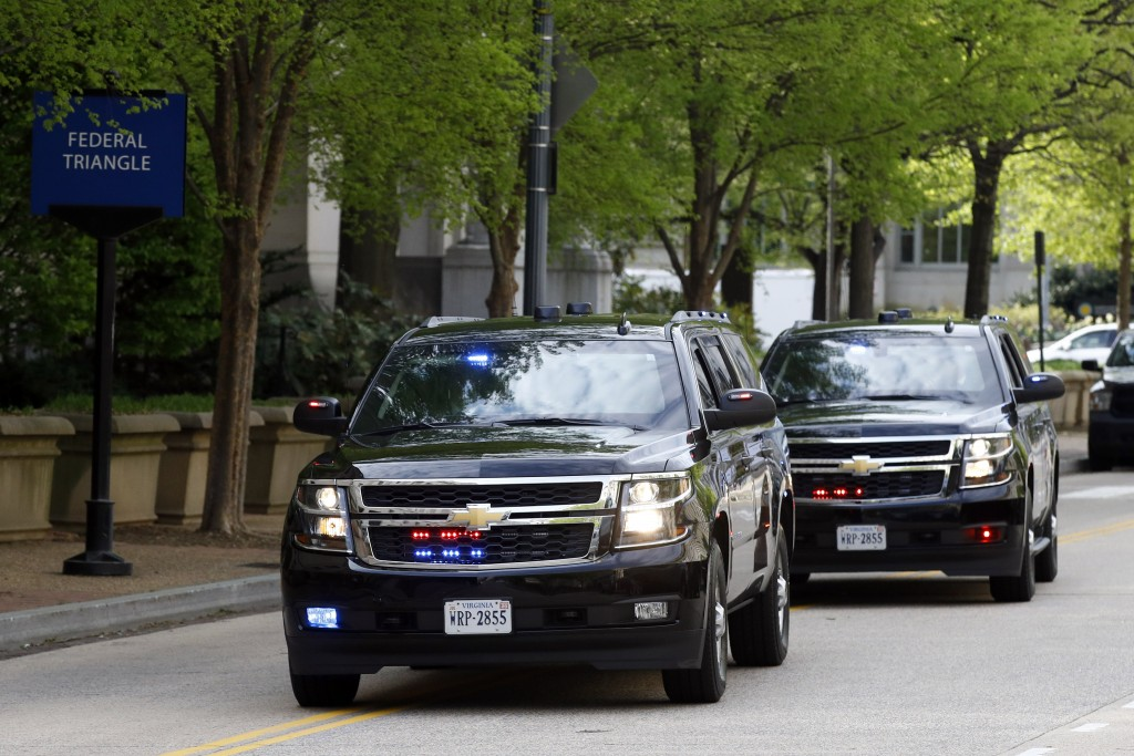 A motorcade for Attorney General William Barr arrives at the Department of Justice, Wednesday, April 17, 2019, in Washington. (AP Photo/Patrick Semans