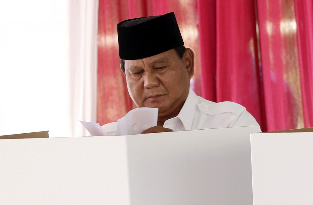 Indonesian presidential candidate Prabowo Subianto casts his ballot during the presidential election at a polling station in Bogor, Indonesia, Wednesd