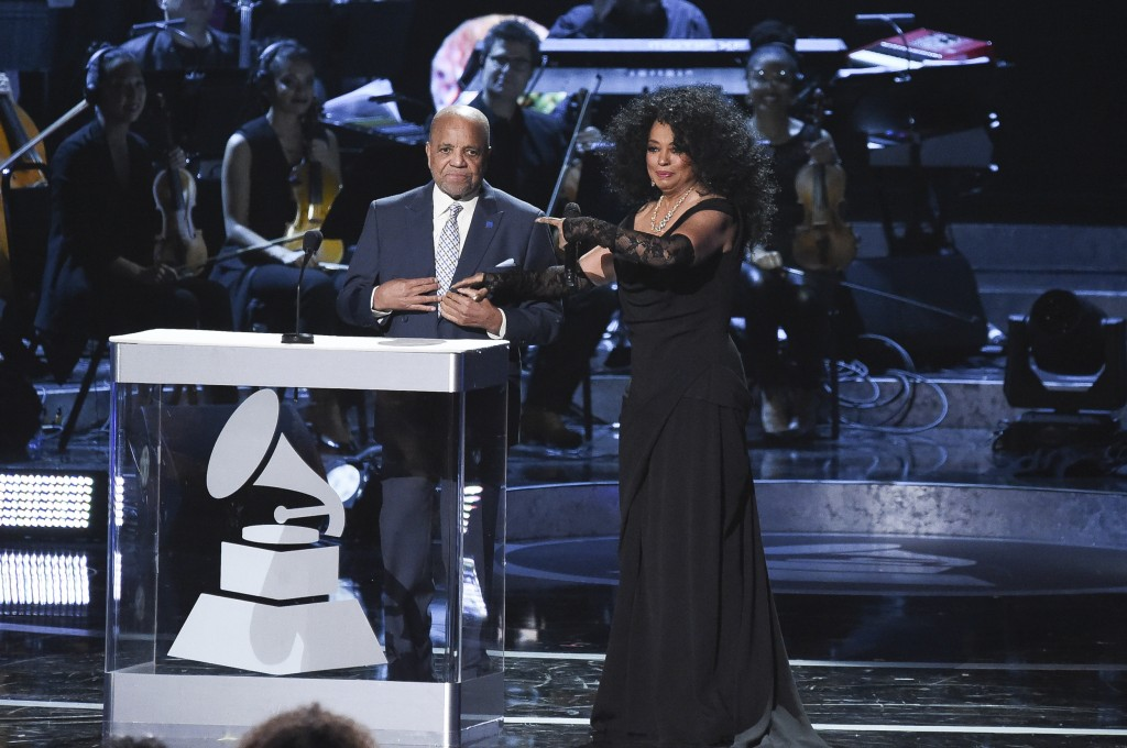 FILE - In this Tuesday, Feb.12, 2019 file photo, Berry Gordy, left, and Diana Ross speak onstage during Motown 60: A GRAMMY Celebration at the Microso...