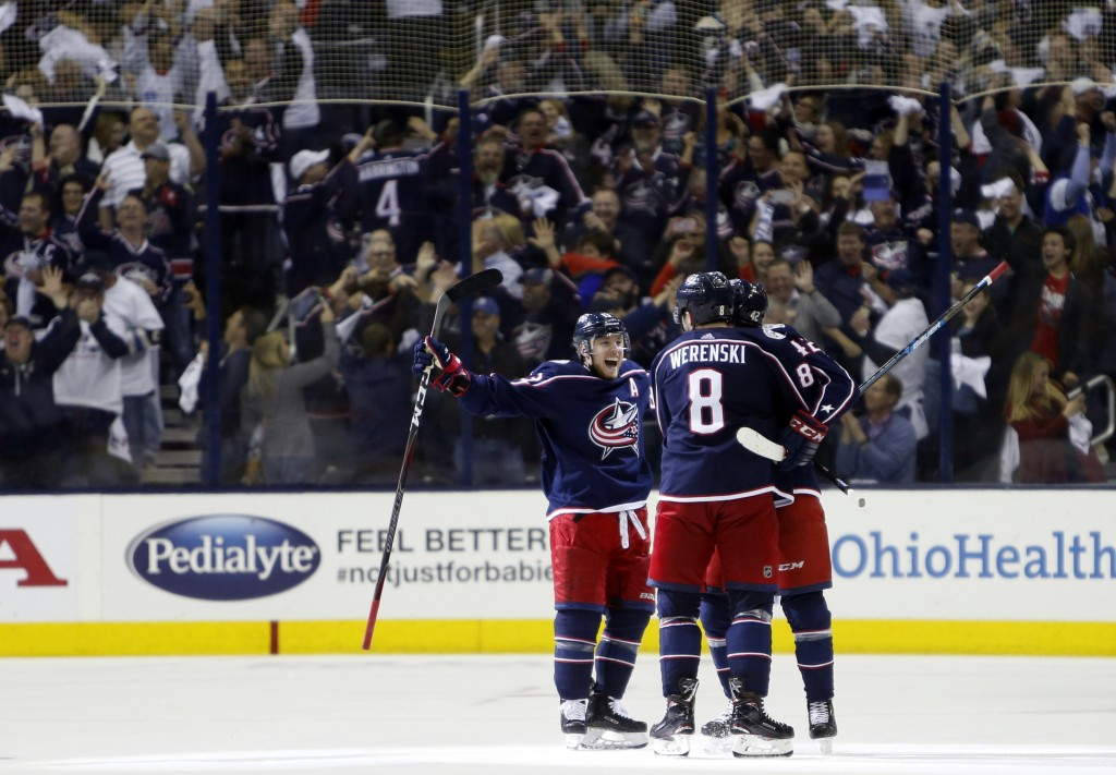 Columbus Blue Jackets players celebrate their goal against the Tampa Bay Lightning during the third period of Game 4 of an NHL hockey first-round play