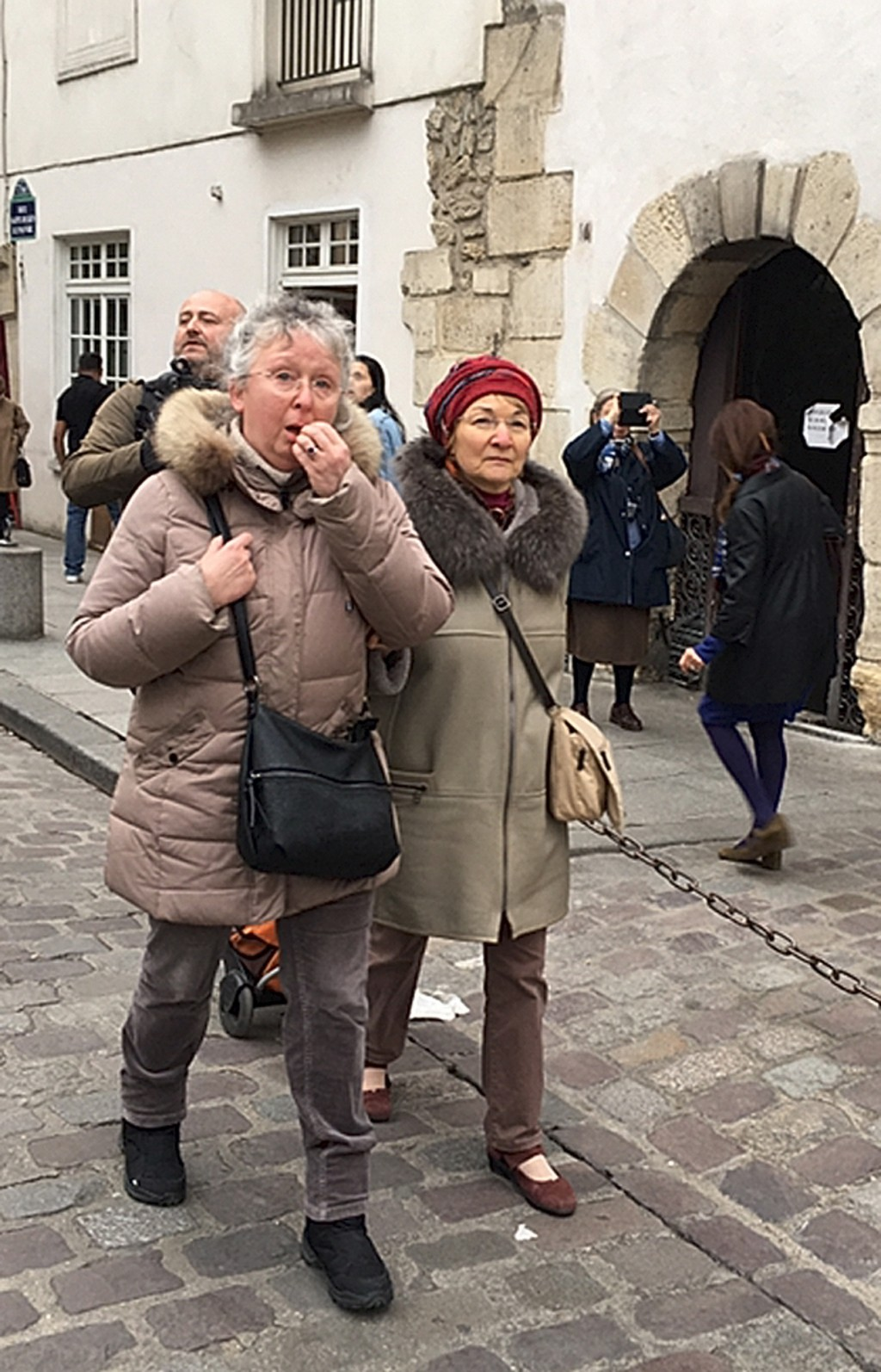 Cecile Deleville, left, and her friend Benedicte Havas walk in Paris Tuesday April 16, 2019. For the 66-year-old Deleville, there is no replacement fo...