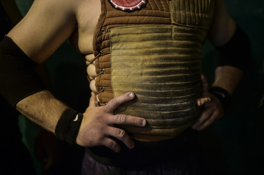 In this Saturday, April 6, 2019 photo, a basque stone lifter waits his turn to hold a stone, during exhibition in the basque village of Azkoitia, nort