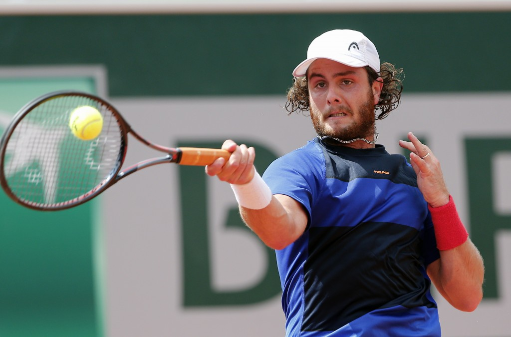 FILE - In this Wednesday, May 30, 2018 file photo Argentina's Marco Trungelliti returns the ball to Italy's Marco Cecchinato during their second round