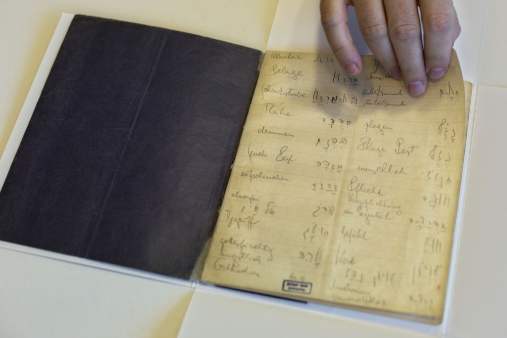 FILE -  In this file photo taken on Oct. 5, 2014, a library official shows celebrated author Franz Kafka's Hebrew vocabulary notebook at Israel's Nati