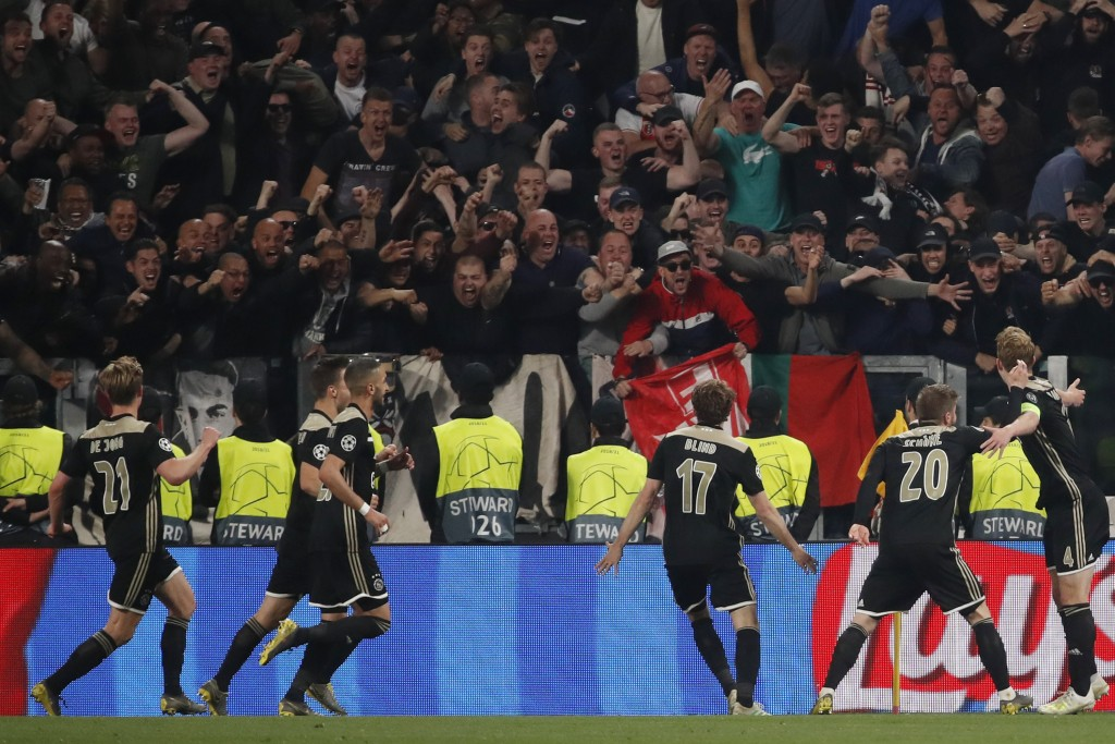Ajax's Matthijs de Ligt, right, celebrates after scoring his side's second goal during the Champions League quarter final, second leg soccer match bet