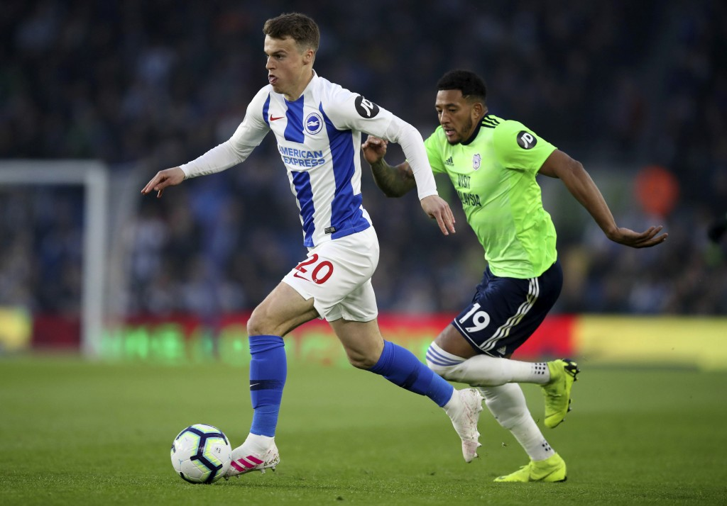 Brighton's Jamie Paterson, left, and Cardiff City's Nathaniel Mendez-Laing battle for the ball during the English Premier League soccer match at the A