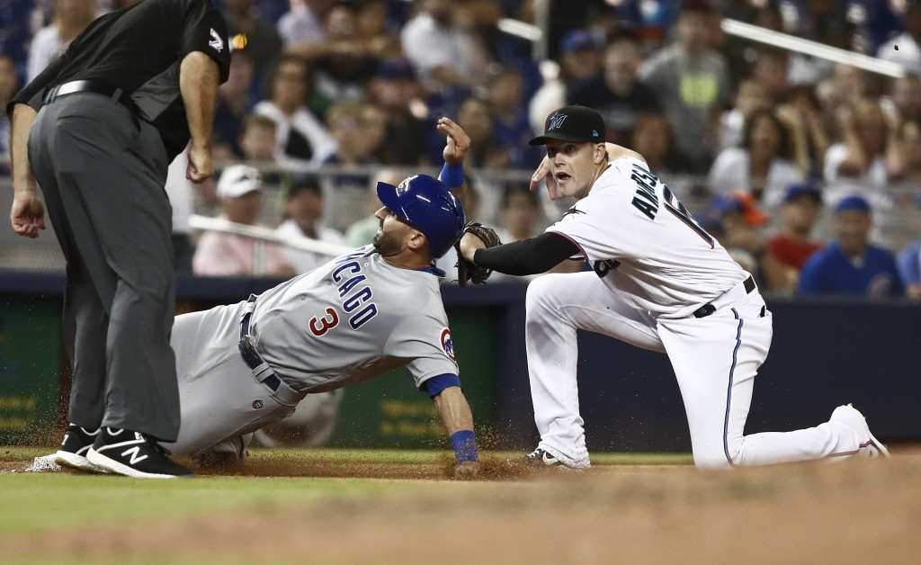 Miami Marlins third baseman Brian Anderson (15) tags out Chicago Cubs' Daniel Descalso (3) after Kris Bryant flies into a double play during the fifth