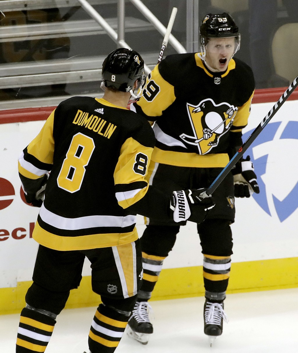 Pittsburgh Penguins' Jake Guentzel celebrates his goal with Brian Dumoulin during the first period in Game 4 of an NHL first-round hockey playoff seri