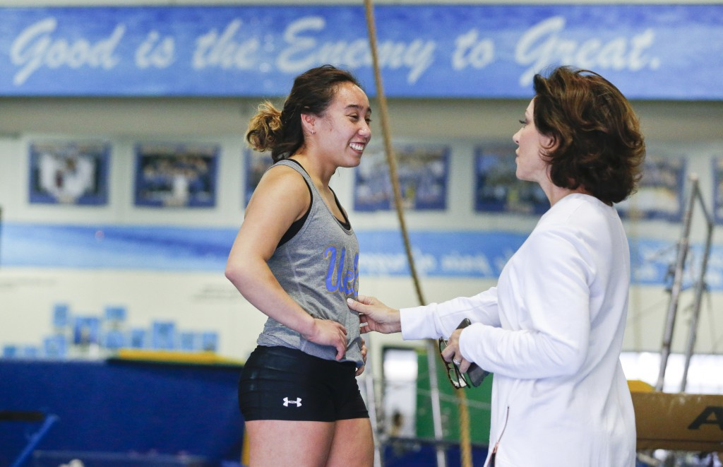 """In this Thursday, April 11, 2019, photo, Gymnast Katelyn Ohashi talks with head coach Valorie Kondos Field, known as """"Miss Val"""" at the University of C"""