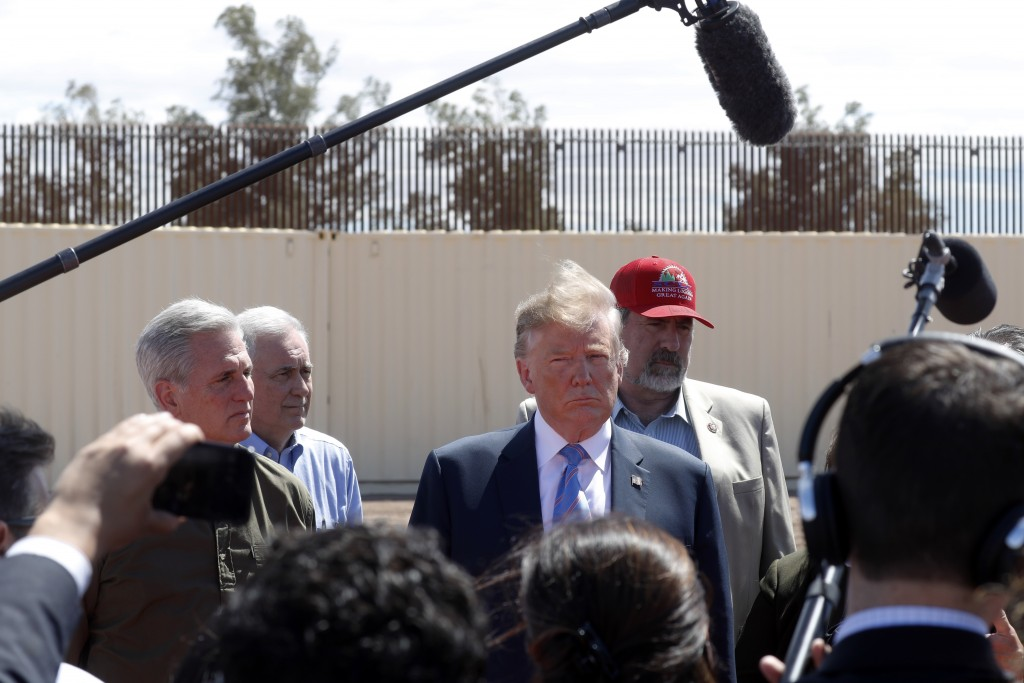 FILE - In this April 5, 2019, file photo, President Donald Trump visits a new section of the border wall with Mexico in Calexico, Calif. When Trump in...