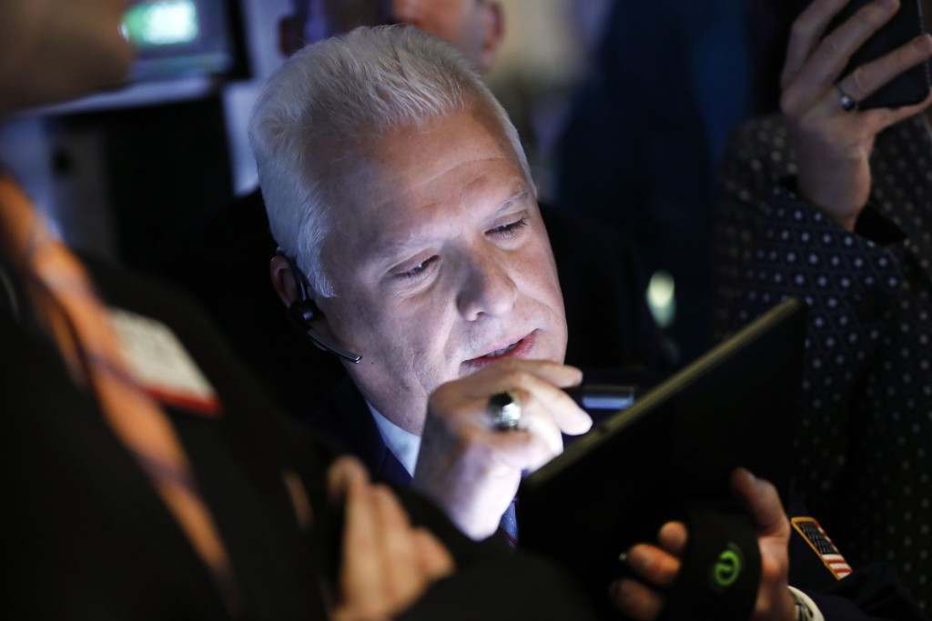FILE - In this April 11, 2019, file photo trader Peter Castelli works on the floor of the New York Stock Exchange. The U.S. stock market opens at 9:30...