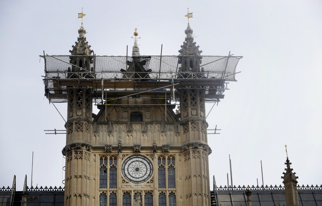 In this photo taken on Wednesday, April 17, 2019, Britain's Houses of Parliament, covered in hoarding and scaffolding as it undergoes restoration work...