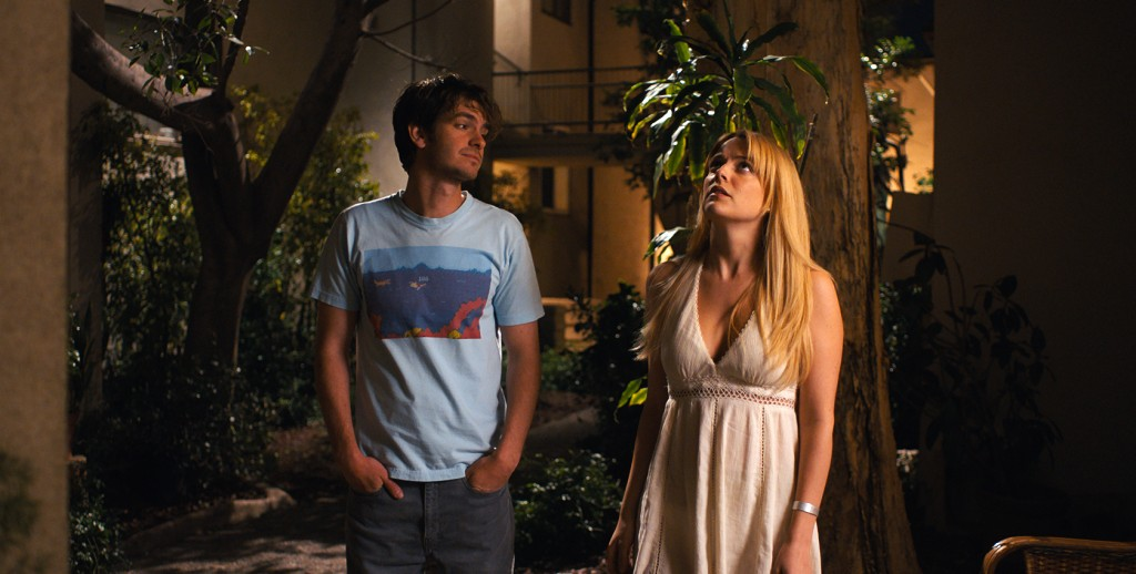 "This image released by A24 shows Andrew Garfield, left, and Riley Keough in a scene from ""Under the Silver Lake."" (A24 via AP)"