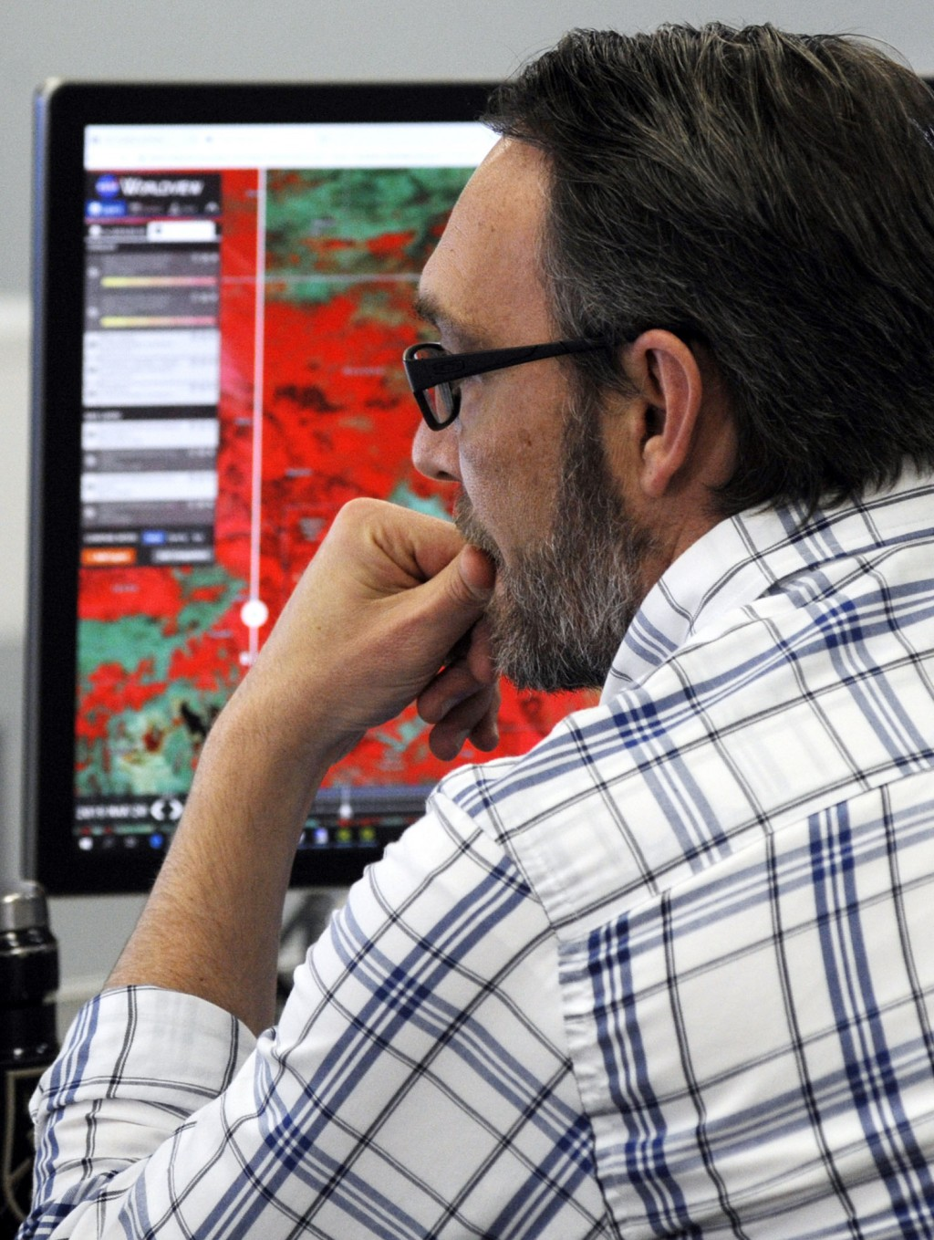 FILE - In this March 21, 2019 file photo, Shawn Carter, an associate scientist at the National Water Center in Tuscaloosa, Ala., works on computer scr...