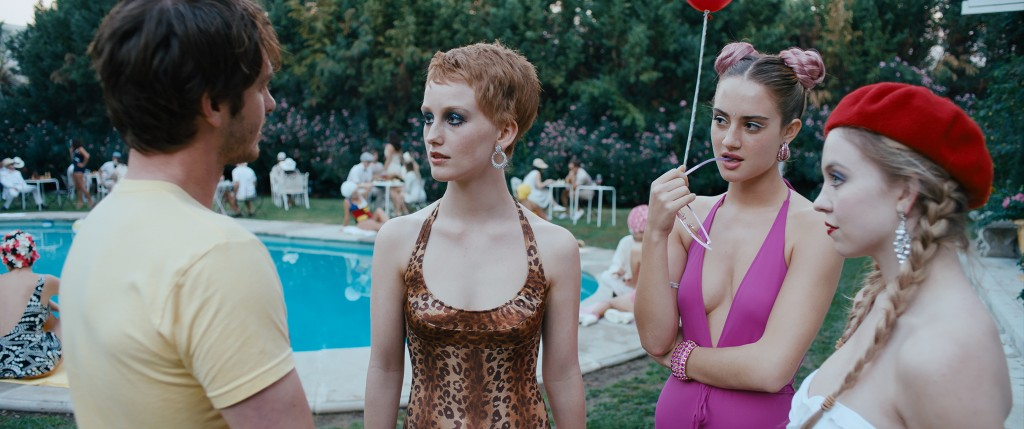 """This image released by A24 shows Andrew Garfield, from left, India Menuez, Grace Van Patten and Sydney Sweeney in a scene from """"Under the Silver Lake."""