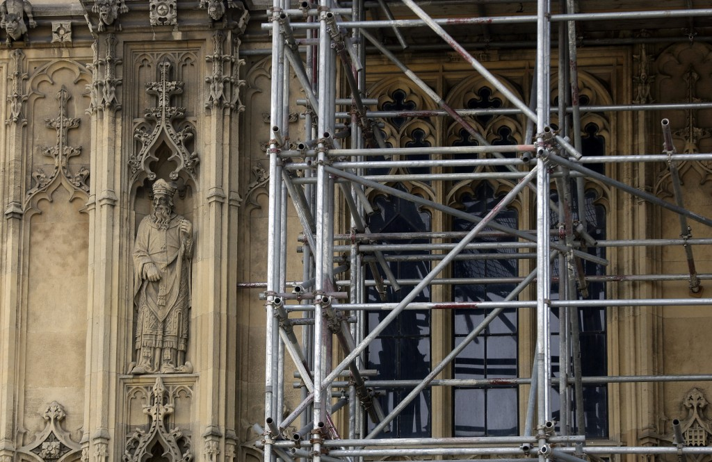 In this photo taken on Wednesday, April 17, 2019, a detailed figure near scaffolding on Britain's Houses of Parliament as it undergoes restoration wor