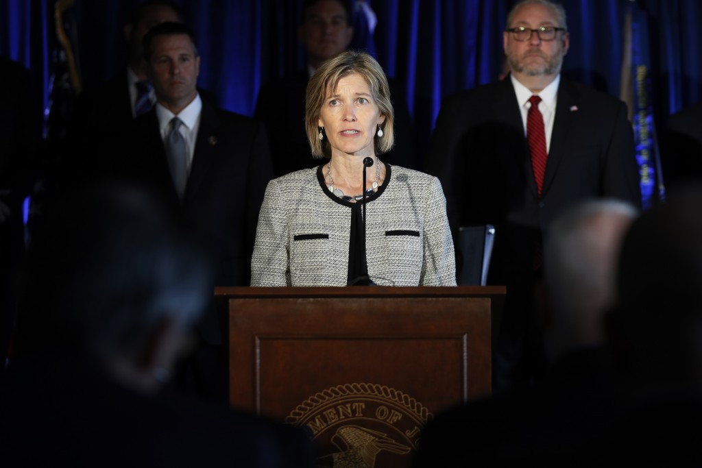 FBI Executive Assistant Director Amy Hess speaks beside members of Appalachian Regional Prescription Opioid Strike Force, during a news conference, We