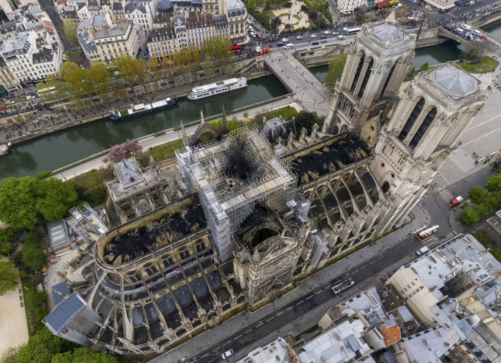 An image made available by Gigarama.ru on Wednesday April 17, 2019 shows an aerial shot of the fire damage to Notre Dame cathedral in Paris on Tuesday