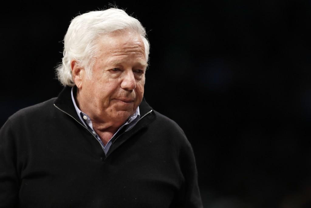 FILE - In this April 10, 2019, file photo, New England Patriots owner Robert Kraft leaves his seat during an NBA basketball game between the Brooklyn ...