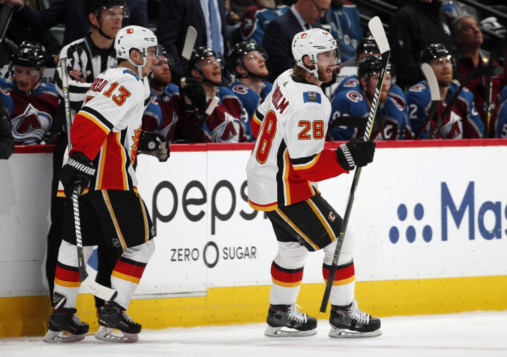 Calgary Flames center Elias Lindholm, right, celebrates his goal with left wing Johnny Gaudreau during the second period of Game 4 of an NHL hockey pl...